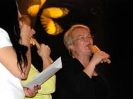 Ramune Stankevičiūtė, Regina, and Ilona Babinskienė perform on skudučiai with