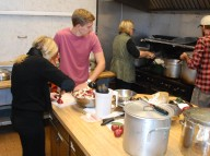 Krista Bard, Virgus Volertas, Jr., Kristina Volertas, and Dan McIntyre prepare Sunday's Lithuanian buffet