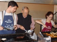 Dr. Michael Mazzei, Antanas Krusinskas, and Victoria Mazzei preparing potato pancakes