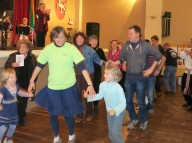Guests practice folk dancing with Žilvinas