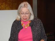 Gema Kreivenas inspects a handwoven Lithuanian folk costume vest