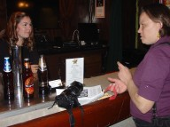 Janė Cox talks with bartender, Laura Salciunas