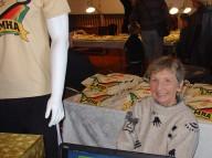 Judy Noyalas selling LMHA's limited edition Mugė t-shirts